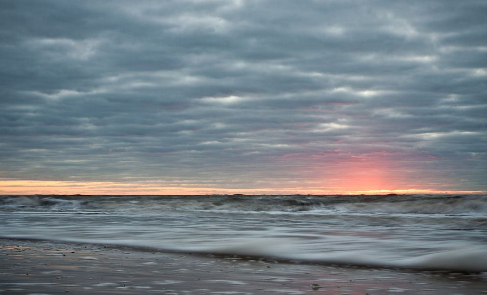 Seascape with light on the horizon