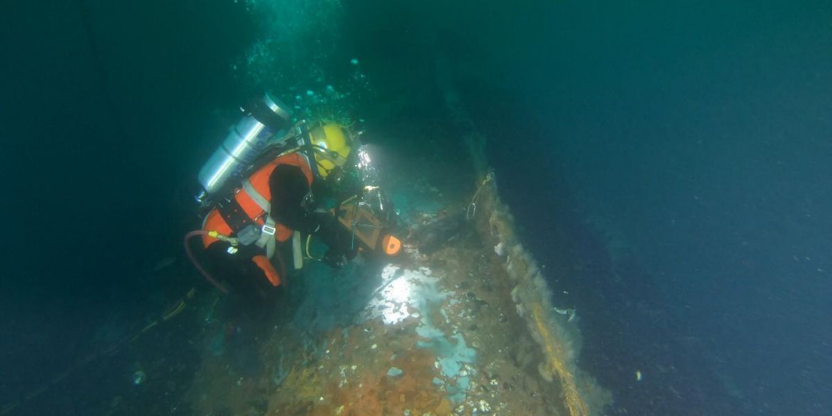 A diver working on a sunken vessel.