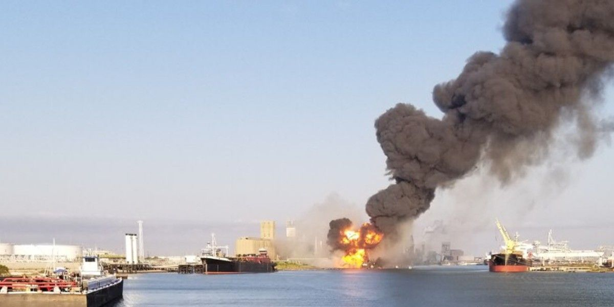 A fire on a shoreline.