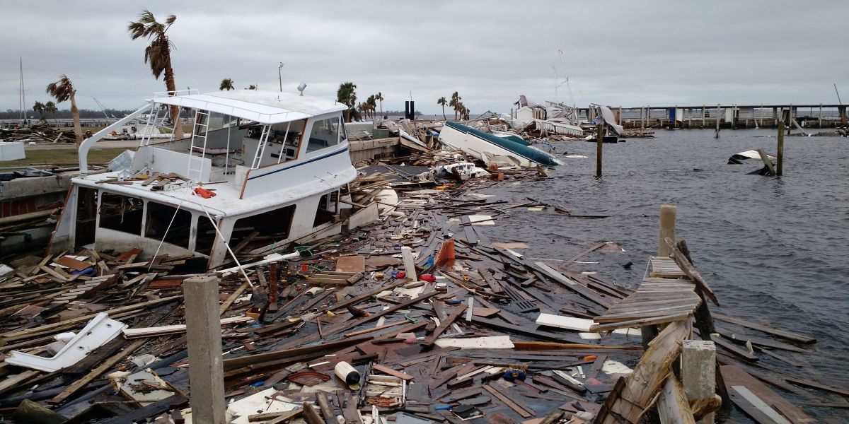 A boat and other debris on a dock.