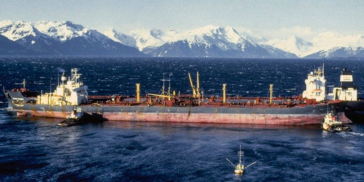 A large vessel with a mountain landscape in the background.