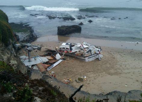 A broken up vessel on a beach.