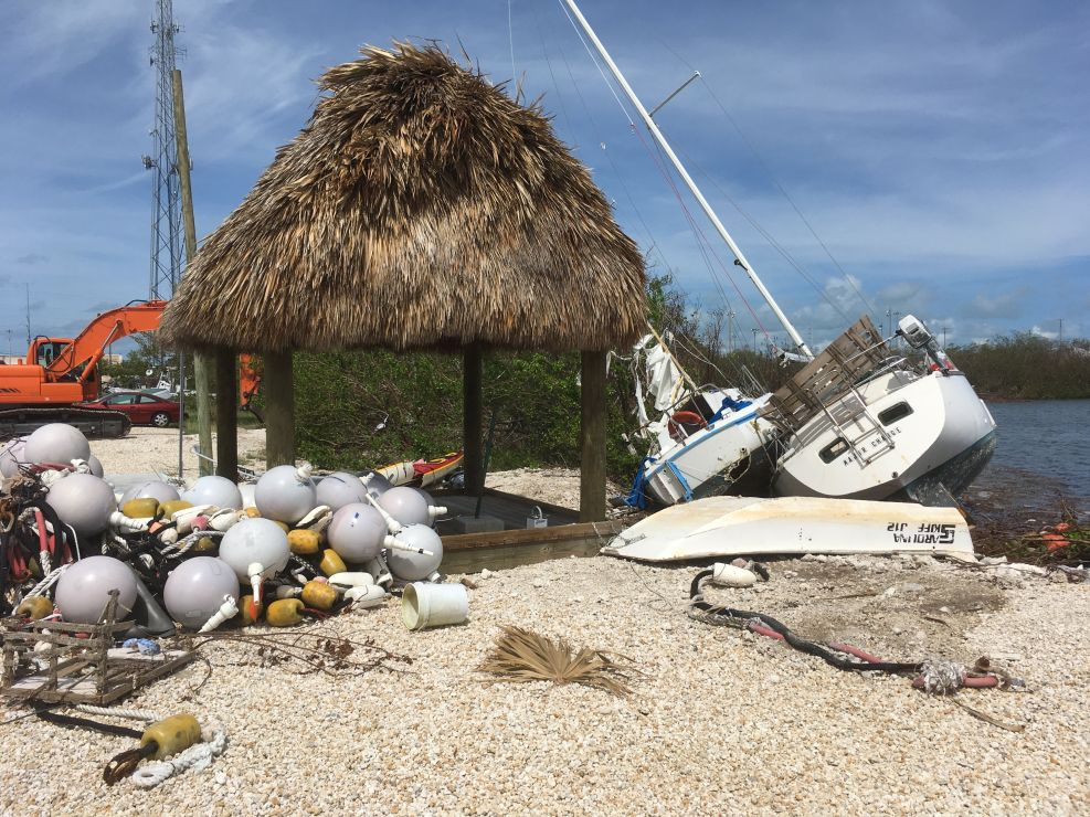 Marine debris and a vessel on a dock.