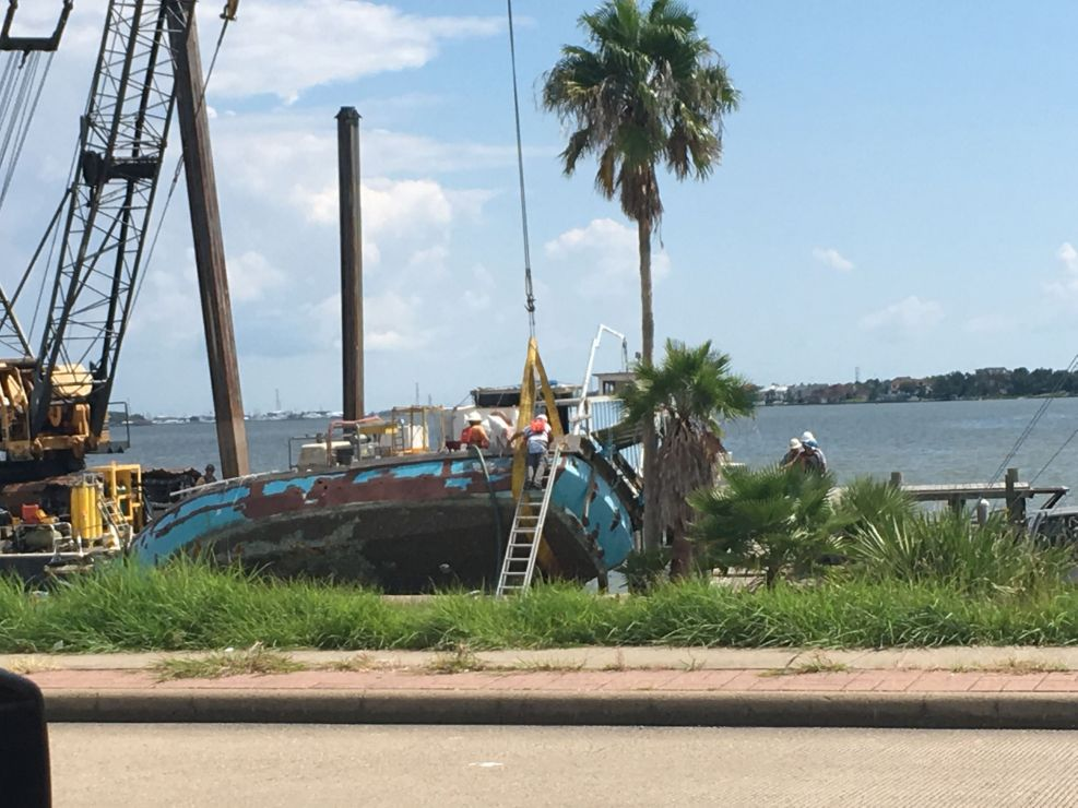 Boat near a beach in the process of being salvaged.