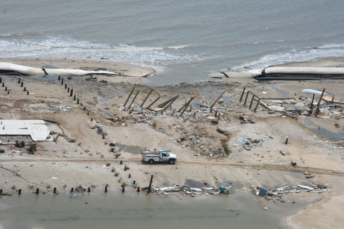 Beach with destroyed structures.