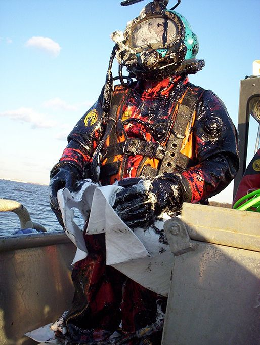 Diver covered in oil.