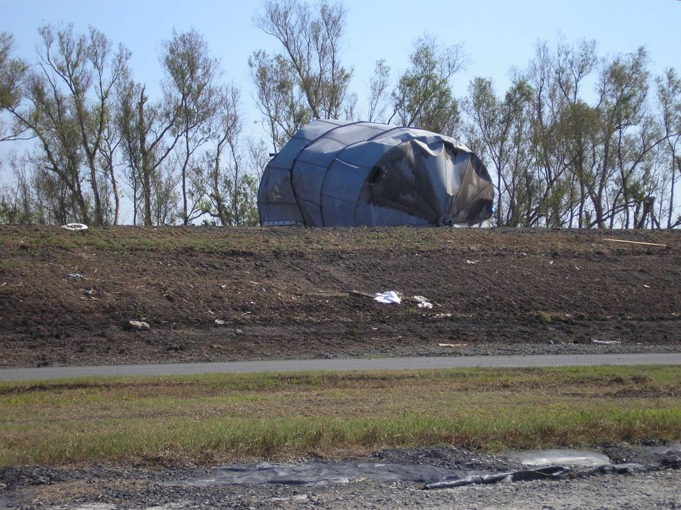 Tank overturned on a levee.