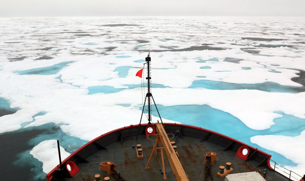 Prow of a Coast Guard icebreaker in ice-filled Arctic waters.