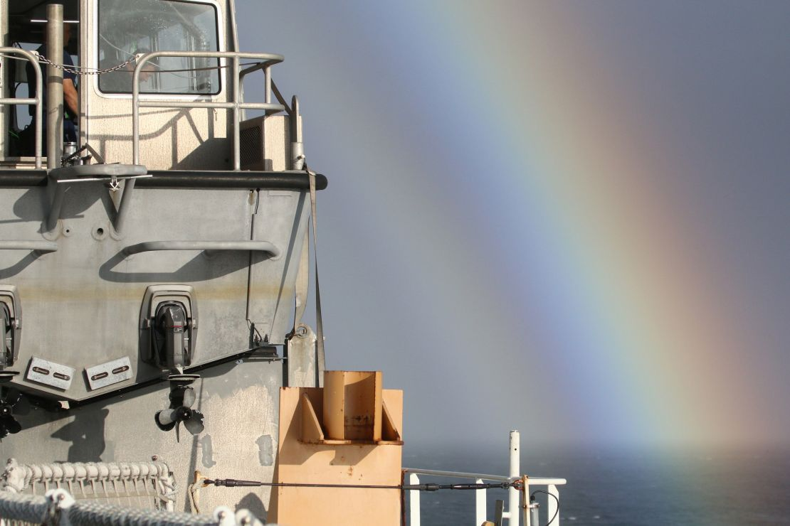 Arctic survey boat with rainbow.