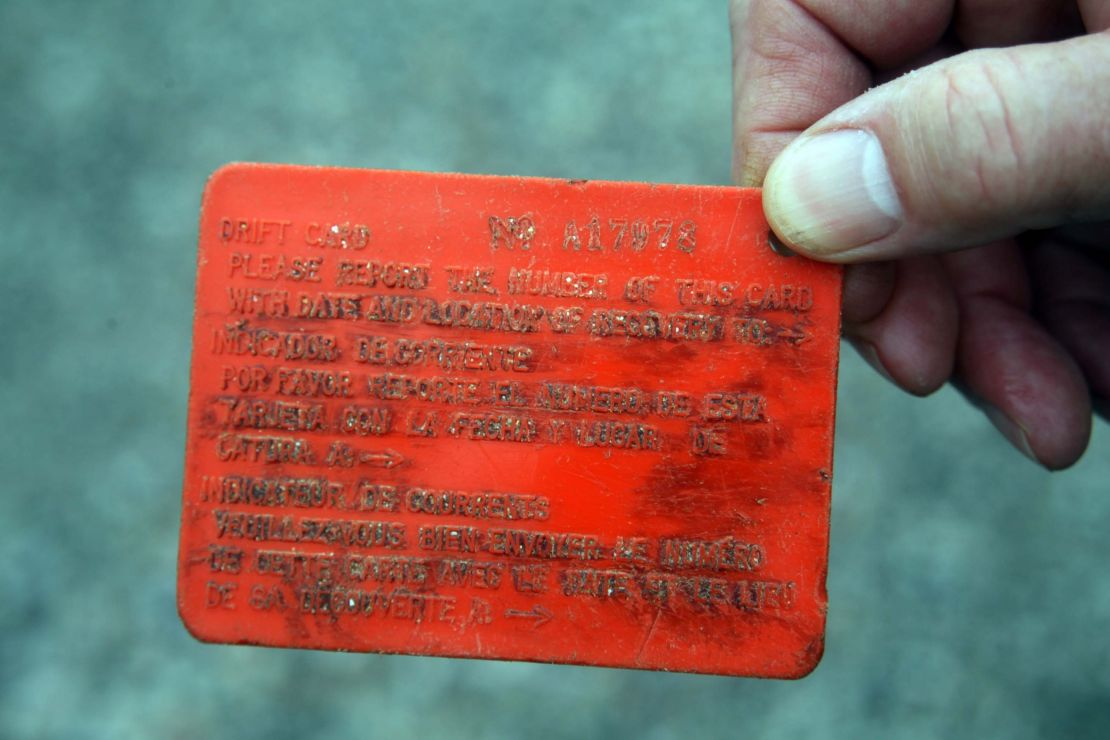 Front of an orange plastic drift card.