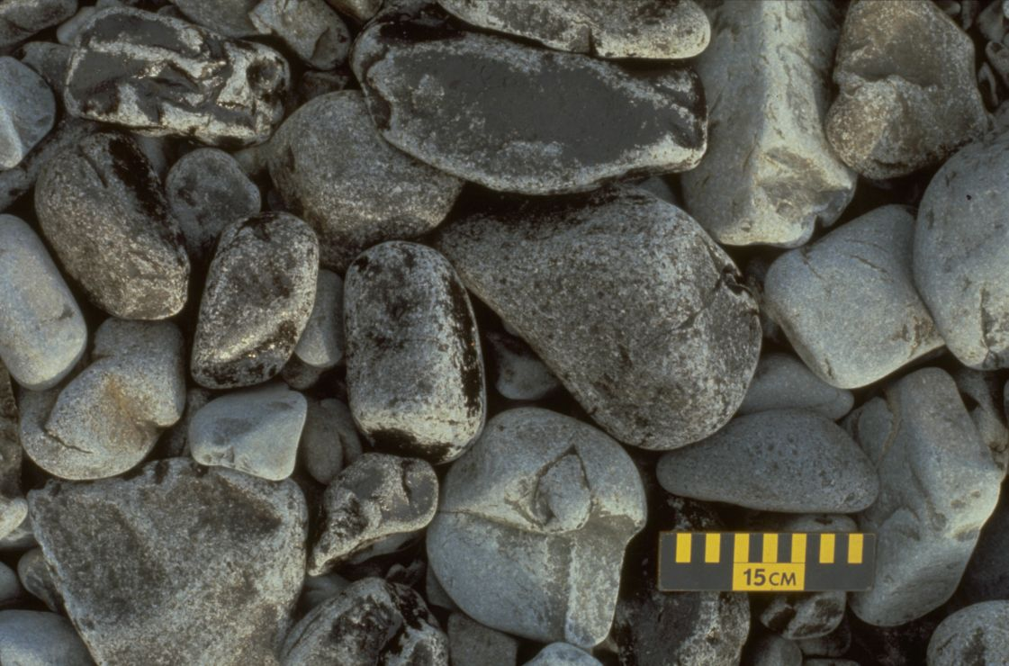 Photo: Large rocks with splotches of oil.