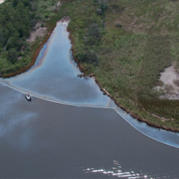An aerial view of an oil sheen on water.