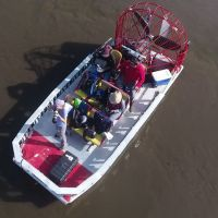 Aerial view of people in a boat