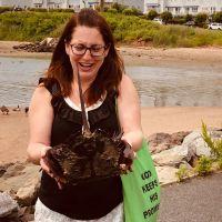Woman holding horseshoe crab.