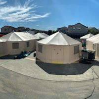 Tents on a paved area.