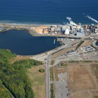 An aerial view of an industrial shoreline.