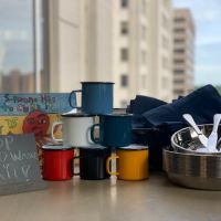 A zero waste kit including cups, dishes, and cutlery.