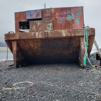 Weathered barge on a beach.