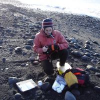Scientist sampling on the beach.