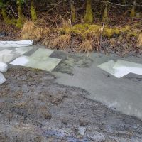 Sorbent material on spilled diesel fuel on a beach