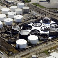 Aerial view of a damaged and burnt tank farm.