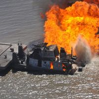 A pipeline burns after it was hit by the tug boat Shanon E. Setton in Louisiana.