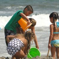 Kids play in the sand the same way they have for generations. (NOAA)