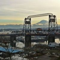Bridge over industrial waterway in Tacoma and view of Mt. Rainier.