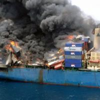 Fire and smoke on a container ship carrying hazardous materials at sea.