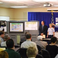 NOAA and Coast Guard at a press conference during Deepwater Horizon oil spill.