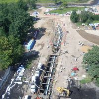Pipeline dug up for an oil spill cleanup next to a creek.