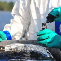 Water and sediment sampling during Enbridge pipeline oil sands spill.