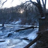 Creek passing over a dam in winter.