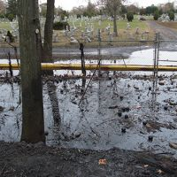 Boom placed to prevent floating oil from reaching a cemetery in New Jersey
