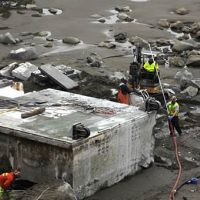 Workers dismantling the Japanese dock washed up on Washington's coast.