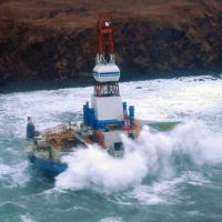 Waves crash over the grounded mobile drilling unit Kulluk.