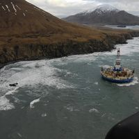 Aerial view of conical drilling unit Kulluk grounded offshore near Kodiak Island