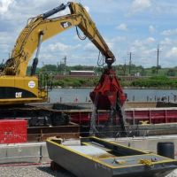 A mechanical dredge pulls contaminated sediment from the bottom of the Passaic R