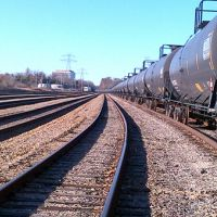 Oil tank cars with railroad tracks.