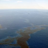 Vessels skim oil from the surface of the Gulf of Mexico.