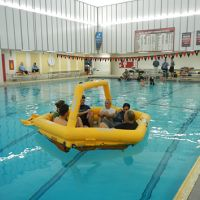 NOAA, with U.S. Coast Guard, practiced their ocean survival skills in a pool.