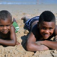 Two boys take a break on the beach in Ocean City, Maryland.