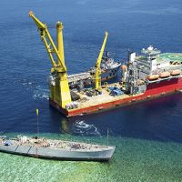 Salvage operations for grounded Navy mine ship Ex-Guardian on Philippines reef.