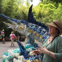 Washed Ashore's Angela Haseltine Pozzi with a giant marlin statue of ocean trash