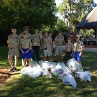 A Coastal Cleanup team poses with collected debris.