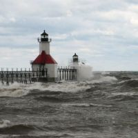 Ocean waves hitting lighthouse.