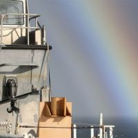 Ship with rainbow.