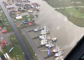 An aerial image of a flooded waterway.