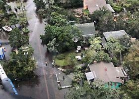 overhead view of a neighborhood after a flood.
