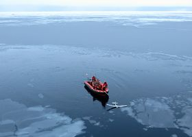 Vessel with small unmanned aircraft in the water.